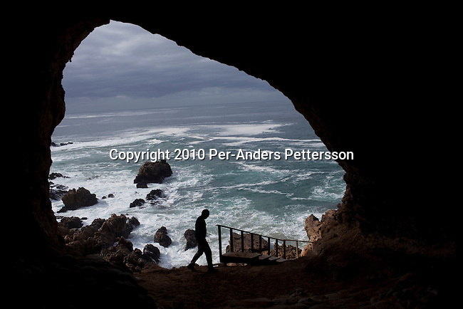 MOSSEL BAY, SOUTH AFRICA - MAY 26: A view of the sea and rocks from inside a cave called PP13B on May 26, 2010, at Pinnacle Point near Mossel Bay South Africa. The cave sheltered humans between 164,000 and 35,000 years ago, at a time when Homo sapiens was in danger of dying out. These people may have been the ancestors of us. (Photo by Per-Anders Pettersson/Getty Images)