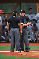 Umpires Jennifer Pawol and Scott Molloy during a game between the GCL Tigers West and GCL Tigers East on August 4, 2016 at Tigertown in Lakeland, Florida.  GCL Tigers West defeated GCL Tigers East 7-3.  (Mike Janes/Four Seam Images)