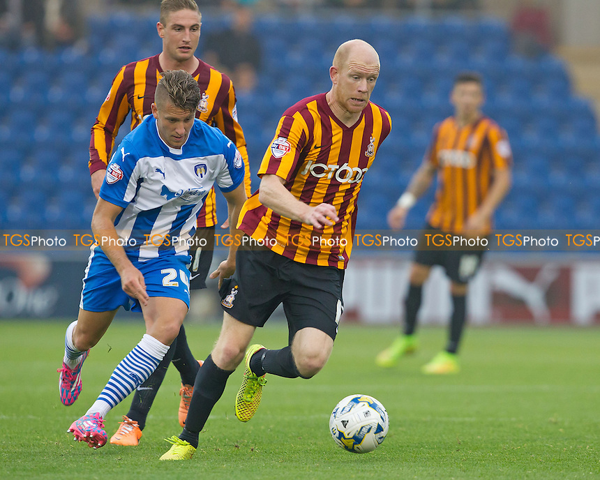 Jason Kenneday of Bradford City nips in to dispossess George Moncur of Colchester United - Colchester United vs Bradford City - Sky Bet League One Football at the Weston Homes Community Stadium, Colchester, Essex - 20/09/14 - MANDATORY CREDIT: Ray Lawrence/TGSPHOTO - Self billing applies where appropriate - contact@tgsphoto.co.uk - NO UNPAID USE