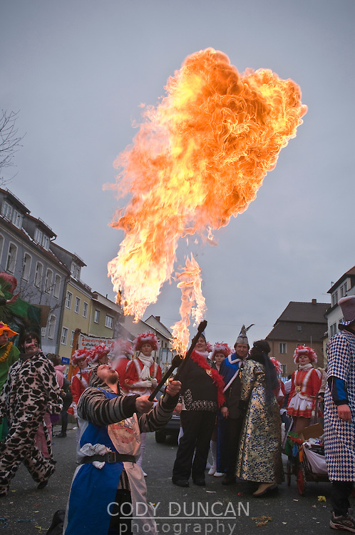 Man breathing fire during Carnival parade; Auerbach in der Oberpfalz; Bavaria; Germany