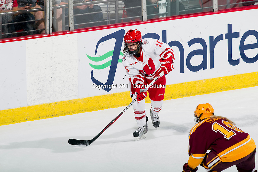 Wisconsin Badgers Saige Pacholok (16) handles the puck during an NCAA women's hockey game against the Minnesota Golden Gophers on October 14, 2011 in Madison, Wisconsin. The Badgers won 3-2. (Photo by David Stluka)