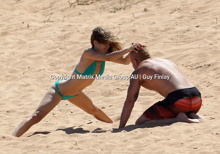 29th December, 2011  Sydney, Australia.**EXCLUSIVE PICTURES**.Dominic Purcell takes his girlfriend, 90210's Anna Lynne McCord to the beach and shows his young twin daughters, Lily and Augustus all about romancing