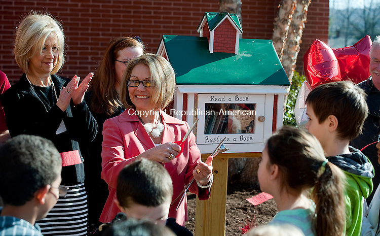 TORRINGTON, CT-041014JS01- Judith Theeb, principal at Southwest School in Torrington, thanks all of those responsible for the Reading Box during a dedication ceremony Thursday at the school. The Reading Box, filled with book that can be taken and returned anytime,  was built to promote the love of reading and a sense of community beyond the school day. <br /> Jim Shannon Republican-American