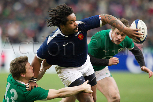13 Februray 2010: Mathieu Bastareaud of France passes the ball as Brian O'Driscoll of Ireland tries to stop him during the six nations match won 33-10 by France over Ireland at the Stade de France stadium in Saint-Denis, near Paris, France..Photo: Christophe Elise/ACTIONPLUS- EDITORIAL USE ONLY
