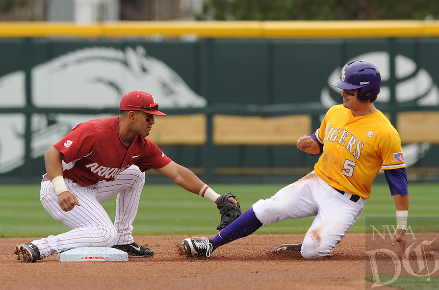 NWA Democrat-Gazette/ANDY SHUPE - Shortstop Michael Bernal (left) of Arkansas tags out Chris Sciambra of LSU during the first inning Saturday, March 21, 2015, at Baum Stadium in Fayetteville. Visit nwadg.com/photos for more photos from the game.