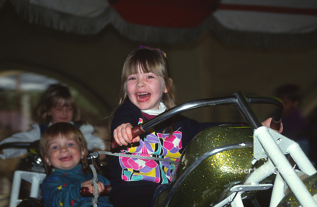Girl in ride at county fair