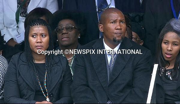 MANDELA FAMILY MEMBERS INCLUDING GRANDSON MANDLA MANDELA (beard)<br /> NELSON MANDELA MEMORIAL<br /> The nation mourns Nelson Rolihlahla Mandela Memorial Service, FNB Stadium, Johannesburg, South Africa<br /> Mandatory Credit Photo: &copy;NEWSPIX INTERNATIONAL<br /> <br /> **ALL FEES PAYABLE TO: &quot;NEWSPIX INTERNATIONAL&quot;**<br /> <br /> IMMEDIATE CONFIRMATION OF USAGE REQUIRED:<br /> Newspix International, 31 Chinnery Hill, Bishop's Stortford, ENGLAND CM23 3PS<br /> Tel:+441279 324672  ; Fax: +441279656877<br /> Mobile:  07775681153<br /> e-mail: info@newspixinternational.co.uk