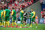 Norwich City 2 Middlesbrough 0, 25/05/2015. Wembley Stadium, Championship Play Off Final. Norwich players head out onto the pitch Nathan Redmond looks to the heavens for some assistance. A match worth £120m to the victors. On the day Norwich City secured an instant return to the Premier League with victory over Middlesbrough in front of 85,656. Photo by Simon Gill.