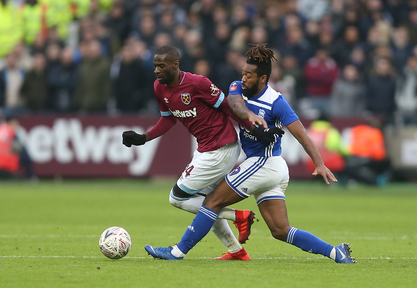 West Ham United's Pedro Obiang and Birmingham City's Jacques Maghoma<br /> <br /> Photographer Rob Newell/CameraSport<br /> <br /> Emirates FA Cup Third Round - West Ham United v Birmingham City - Saturday 5th January 2019 - London Stadium - London<br />  <br /> World Copyright © 2019 CameraSport. All rights reserved. 43 Linden Ave. Countesthorpe. Leicester. England. LE8 5PG - Tel: +44 (0) 116 277 4147 - admin@camerasport.com - www.camerasport.com