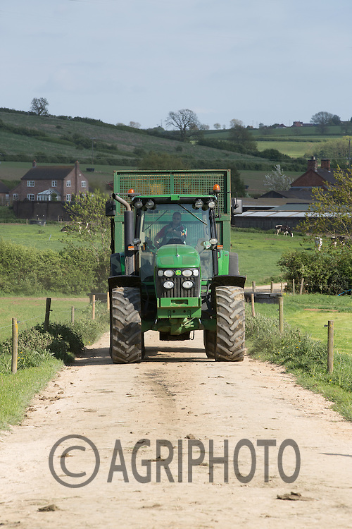 Tractor and Trailer carting silage back to the clamp in the farmyard.Picture Tim Scrivener 07850 303986.tim@agriphoto.com.?.covering agriculture in the UK?.