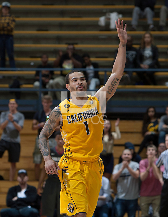 Justin Cobbs of California celebrates with the fans during 2014 National Invitation Tournament against Arkansas at Haas Pavilion in Berkeley, California on March 24th, 2014.  California defeated Arkansas, 75-64.