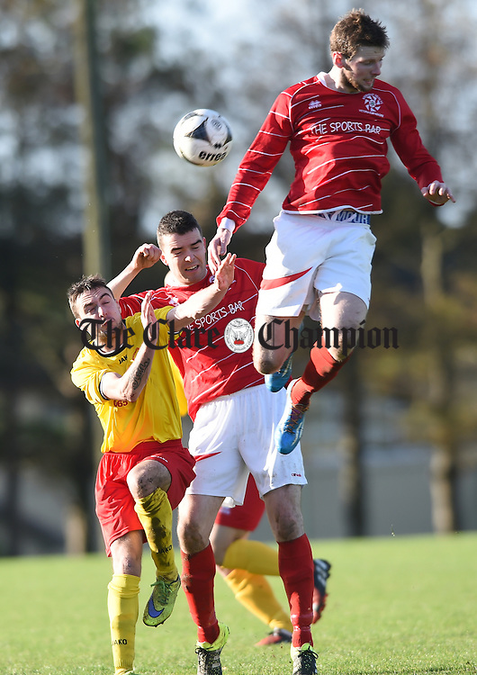 Scott Hennessy of Avenue United A in action against David O Grady and Colin Smyth of Newmarket Celtic A during their FAI Junior Cup fourth round game at Mc Donough Park. Photograph by John Kelly.