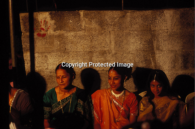 dicomau00010.Foreign Country Mauritius. Unidentified wedding guests at a Hindu wedding in a house in Grand Bayon July 2, 2003, in Grand Bay on Mauritius. The island is mainly Hindu but also Christian and Muslim. The island, located in the Indian Ocean, is a popular place for tourists. .©Per-Anders Pettersson/ iAfrika Photos