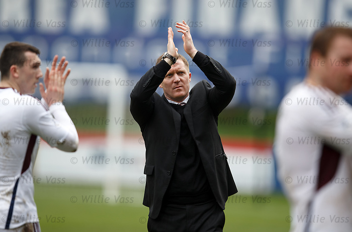 Gary Locke applauds the travelling Hearts fans at the end of the match