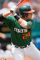 Yasmani Grandal #24 of the Miami Hurricanes at bat against the Virginia Cavaliers at the 2010 ACC Baseball Tournament at NewBridge Bank Park May 29, 2010, in Greensboro, North Carolina.  The Cavaliers defeated the Hurricanes 12-8.  Photo by Brian Westerholt / Four Seam Images