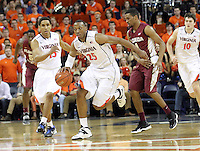 Virginia forward Akil Mitchell (25) drives down court next to Virginia guard Malcolm Brogdon (15) and Florida State guard Devon Bookert (1) during the second half of an NCAA basketball game Saturday Jan. 18, 2014 in Charlottesville, VA. Virginia defeated Florida State 78-66. (AP Photo/Andrew Shurtleff)