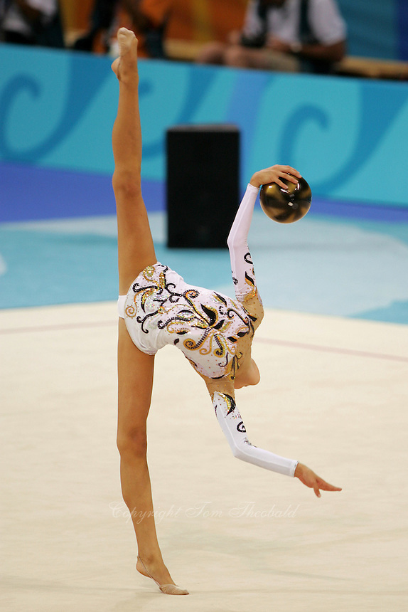 Dominika Cervenkova of Czech Republic turns pivot with ball during qualifications round at Athens Olympic Games on August 26, 2004 at Athens, Greece. (Photo by Tom Theobald)