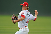 Pitcher Michael Kopech (34) of the Greenville Drive warms up before a game against the Savannah Sand Gnats on Thursday, May 7, 2015, at Fluor Field at the West End in Greenville, South Carolina. Kopech was a first-round pick of the Boston Red Sox in the 2014 First-Year Player Draft. Savannah won in 11, 7-5. (Tom Priddy/Four Seam Images)