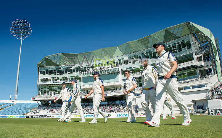 Picture by Allan McKenzie/SWpix.com - 26/04/2015 - Cricket - LV County Championship Div One - Yorkshire County Cricket Club v Warwickshire County Cricket Club - Headingley Cricket Ground, Leeds, England - Yorkshire take to the field for their first home game of the summer.