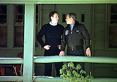 """Thurmont, MD - February 23, 2001 -- United States President George W. Bush and Prime Minister Tony Blair of Great Britain chat on the porch of the """"Holly"""" cabin at Camp David, near Thurmont, Maryland on February 23, 2001..Credit: Martin H. Simon - Pool / CNP"""