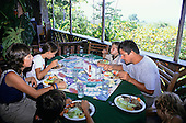 Osa Peninsula, Costa Rica. Marenco ecotourist lodge; family eating in the open-air restaurant; sea view.