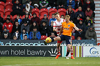 Eoin Doyle (R) under pressure from  Doncaster Rovers' Joe Wright (L) during the Sky Bet League 1 match between Doncaster Rovers and Oldham Athletic at the Keepmoat Stadium, Doncaster, England on 16 December 2017. Photo by Juel Miah / PRiME Media Images.