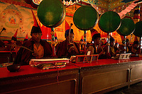 Buddhist monks with drums during the Losar procession in Sikkim India