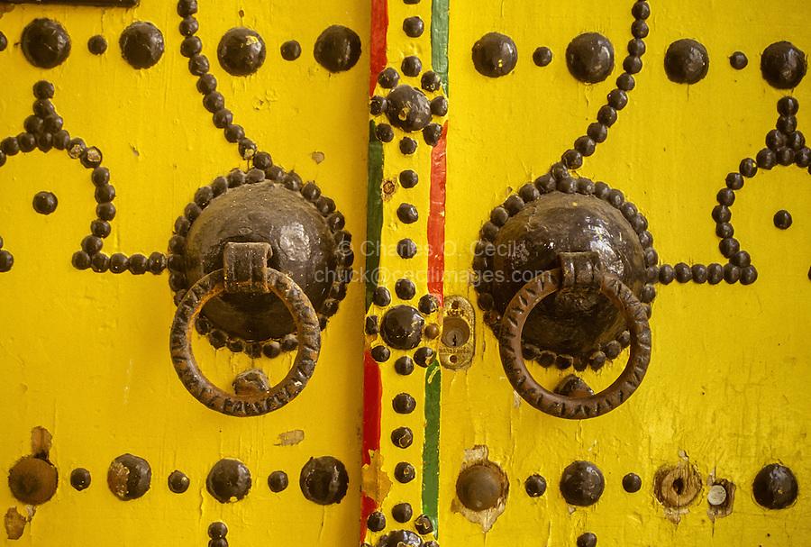 Tunisia.  Tunis Medina.  Door Knockers on Decorated Door.