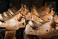 Trophy saddles await winning riders at the College National Finals Rodeo in Casper, Wyo., Saturday, June 18, 2011. Unlike college athletes in other sports, student rodeo atheletes are allowed to compete for money and sign with sponsors. (Kevin Moloney for the New York Times)