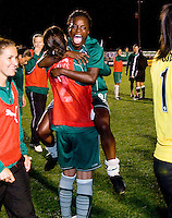 St. Louis Athletica forward Enoila Aluko (9) jumps into the arms of St Louis Athletica forward Kerri Hanks (2) after their WPS match against FC Gold Pride at Korte Stadium, in St. Louis, MO, May 9 2009. St. Louis Athletica won the match 1-0.