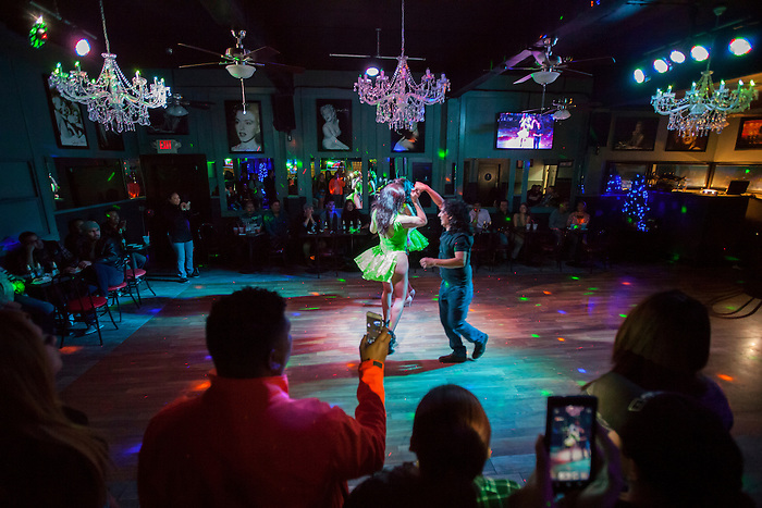 A patron dances with Melanie Machetto during the show at Franco's Norma Jean's Nightclub in Castroville, Calif. on December 18, 2015.