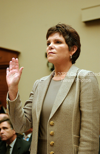 """Washington, D.C. - September 28, 2006 -- Patricia Dunn, former Chairman of the Board, Hewlett-Packard Company, is sworn-in to testify before the United States House Subcommittee on Oversight and Investigations hearing on """" Hewlett-Packard's Pretexting Scandal"""" in Washington, D.C. on September 28, 2006..Credit: Ron Sachs / CNP.[No New York Metro or other Newspapers within a 75 mile radius of New York City]"""
