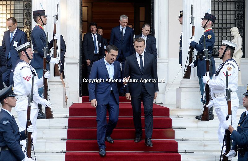 Pictured: (L-R) French President Emmanuel Macron is escorted by Greek Prime Minister Alexis Tsipras out of Maximos Mansion in Athens, Greece. Thurday 07 September 2017<br />Re: French President Emmanuel Macron state visit to Athens, Greece.