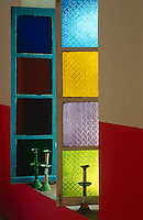 Detail of the colourful stained glass windows that open into the bedroom