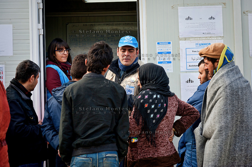 Staff of the United Nations High Commissioner for Refugees assists refugees the Greek-Macedonian border at the village of Idomeni, Greece, 8 Febraury 2016.<br /> Hundreds of refugees arrive at Idomeni and cross the border between Greece and Macedonian on their journey to North Europe.