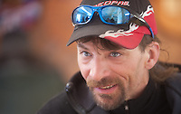 Lance Mackey talks with a reporter during a stop in Anvik during the 2011 Iditarod.