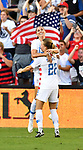 Alex Morgan of USA is hugged by teammate Emily Sonnett (right) after Morgan scored her second goal against Japan in the second of two Tournament of Nations games at Children's Mercy Park in Kansas City, Kansas on July 26, 2018.<br /> Photo by Tim Vizer