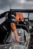 Sept. 1, 2013; Clermont, IN, USA: A crew member helps NHRA top fuel dragster driver Bob Vandergriff Jr during qualifying for the US Nationals at Lucas Oil Raceway. Mandatory Credit: Mark J. Rebilas-