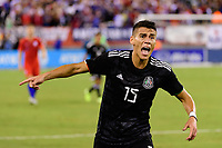 EAST RUTHERFORD, NJ - SEPTEMBER 7: Hector Moreno #15 of Mexico yells at the assistant referee during a game between Mexico and USMNT at MetLife Stadium on September 6, 2019 in East Rutherford, New Jersey.