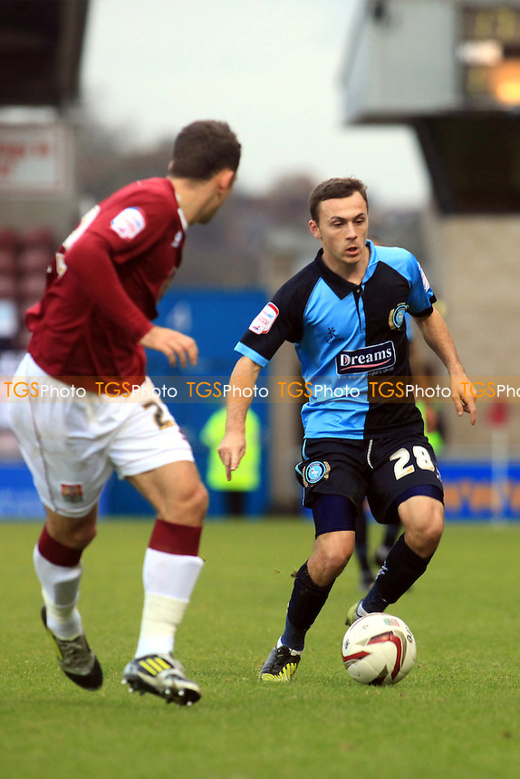 Wycombe's Josh Scowen dribbles the ball upfield - Northampton Town vs Wycombe Wanderers - NPower League Two Football at Sixfields Stadium, Northampton - 17/11/12 - MANDATORY CREDIT: Paul Dennis/TGSPHOTO - Self billing applies where appropriate - 0845 094 6026 - contact@tgsphoto.co.uk - NO UNPAID USE.