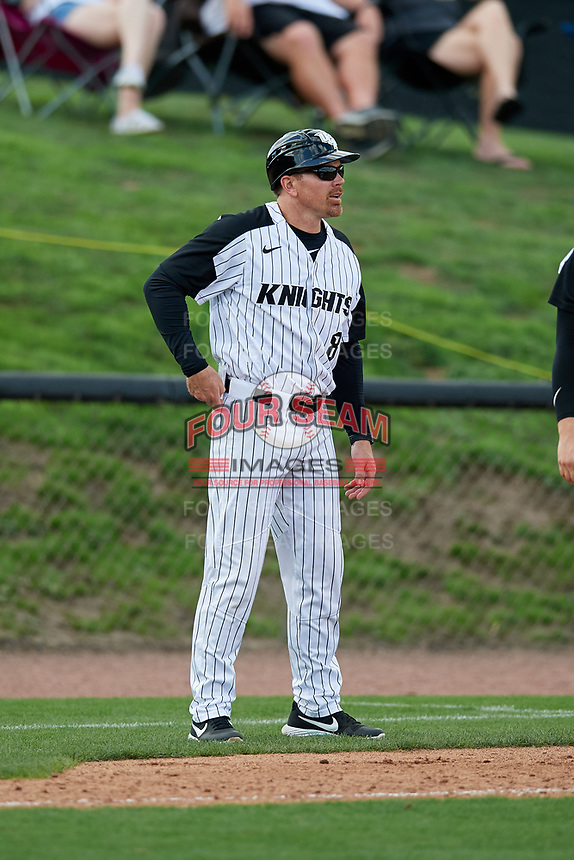 UCF Knights assistant coach Ryan Klosterman (8) during a game against the Siena Saints on February 17, 2019 at John Euliano Park in Orlando, Florida.  UCF defeated Siena 7-1.  (Mike Janes/Four Seam Images)