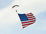 (Chicopee, MA, 07/15/18) A skydiver with a large American flag descends during the Great New England Air and Space Show at Westover Air Reserve Base in Chicopee on Sunday, July 15, 2018. Staff photo by Christopher Evans