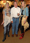 Cindi Colvin, David Elder and Melinda Snell at the Cattle Baron's Ball at the George Ranch Saturday April 28,2007.(Dave Rossman/For the Chronicle)