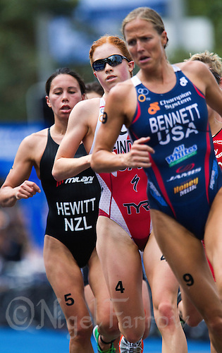 10 APR 2011 - SYDNEY, AUS - Paula Findlay (centre) trails Laura Bennett during the women's ITU World Championship Series triathlon in Sydney, Australia (PHOTO (C) NIGEL FARROW)