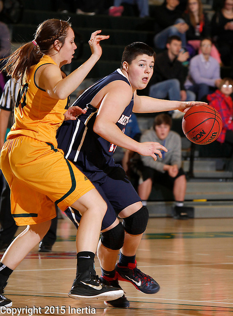 JANUARY 31, 2015 -- Emily Hartegan #41 of Metro State drives on Remi Wientjes #10 of Black Hills State during their Rocky Mountain Athletic Conference women's basketball game Saturday evening at the Donald E. Young Center in Spearfish, S.D.  (Photo by Dick Carlson/Inertia)