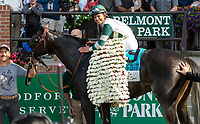 ELMONT, NY - JUNE 10: Mike Smith, aboard Mor Spirit #9, celebrates in the winner's circle after winning the Mohegan Sun Metropolitan Handicap on Belmont Stakes Day at Belmont Park on June 10, 2017 in Elmont, New York (Photo by Sue Kawczynski/Eclipse Sportswire/Getty Images)