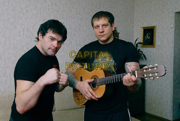 Evgeniy Dyatlov & Fedor Emelyanenko.House photosession.April 27th, 2008.half length black t-shirt tattoos guitar fists .CAP/PER/VB.©VB/PersonaStars/CapitalPictures