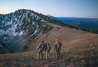 Outdoor Life Editor Andrew McKean, Mike Stock, and guide Greg Kriese with Trefren Outfitters plan a mule deer hunt on Greyback Ridge in the Hoeback Drainage of Wyoming Region H, outside of Alpine, Wyoming, September 21, 2015.<br /> <br /> Photo by Matt Nager