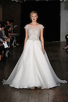"""Model walks runway in a """"Heart"""" bridal gown from the Alyne by Rita Vinieris Fall 2017 collection on October 7th, 2016 during New York Bridal Fashion Week."""