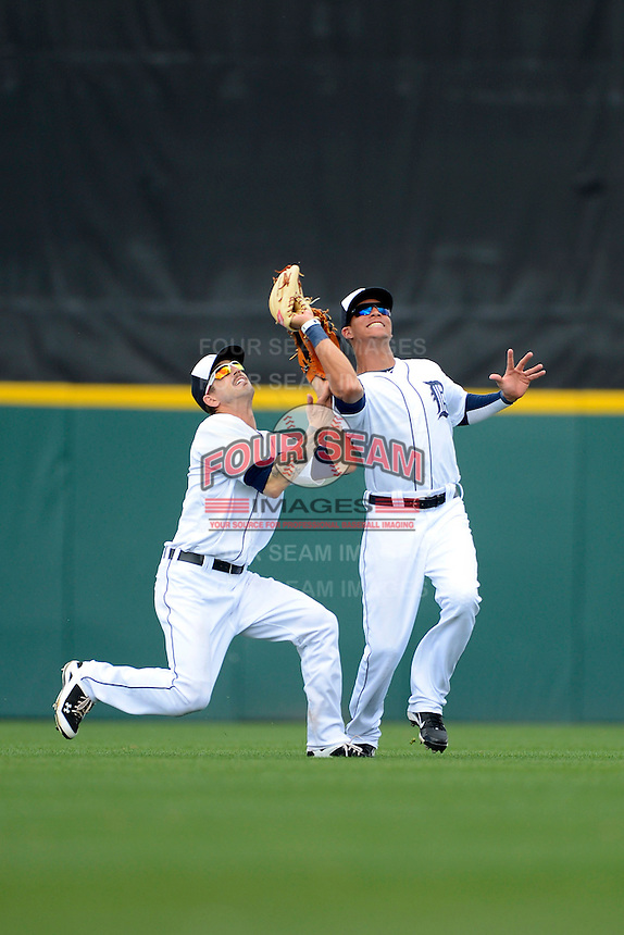 Detroit Tigers outfielders Jeff Kobernus #46 and Quintin Berry #52 collide as Berry catches a fly ball during a Spring Training game against the New York Mets at Joker Marchant Stadium on March 11, 2013 in Lakeland, Florida.  New York defeated Detroit 11-0.  (Mike Janes/Four Seam Images)